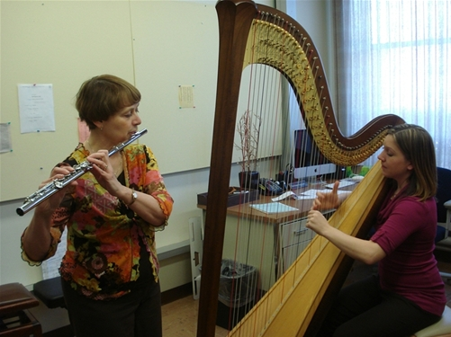 Flutest Janet Stodd and harpist Dr. Erin Freund rehearse for the upcoming St. Patrick's Day concert.