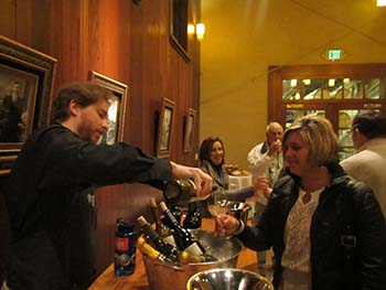 At the San Antonio Winery in Los Angeles, Augustana alumni enjoy wine tasting, which was not among approved campus activities when they were students.