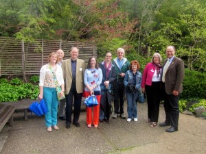 Steve and Jane pause for a photo with alumni and friends at the Anderson Japanese Gardens in Rockford.