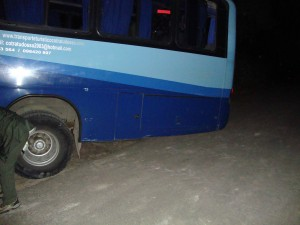 our bus...completely wedged and scraping the road