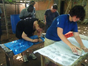 Sarah and Margaret working on their Batik by stamping wax onto the fabric before putting it into the dye