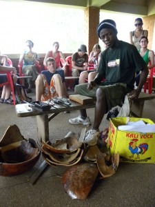 Another teacher, Paul, showing us how to cut the calabash into Adinkra stamps