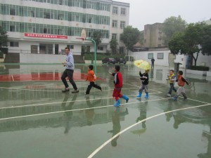 We stopped at a grade school in Wuhan, where the kids played chase the giant.