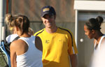 Coach Strand with the women's tennis team